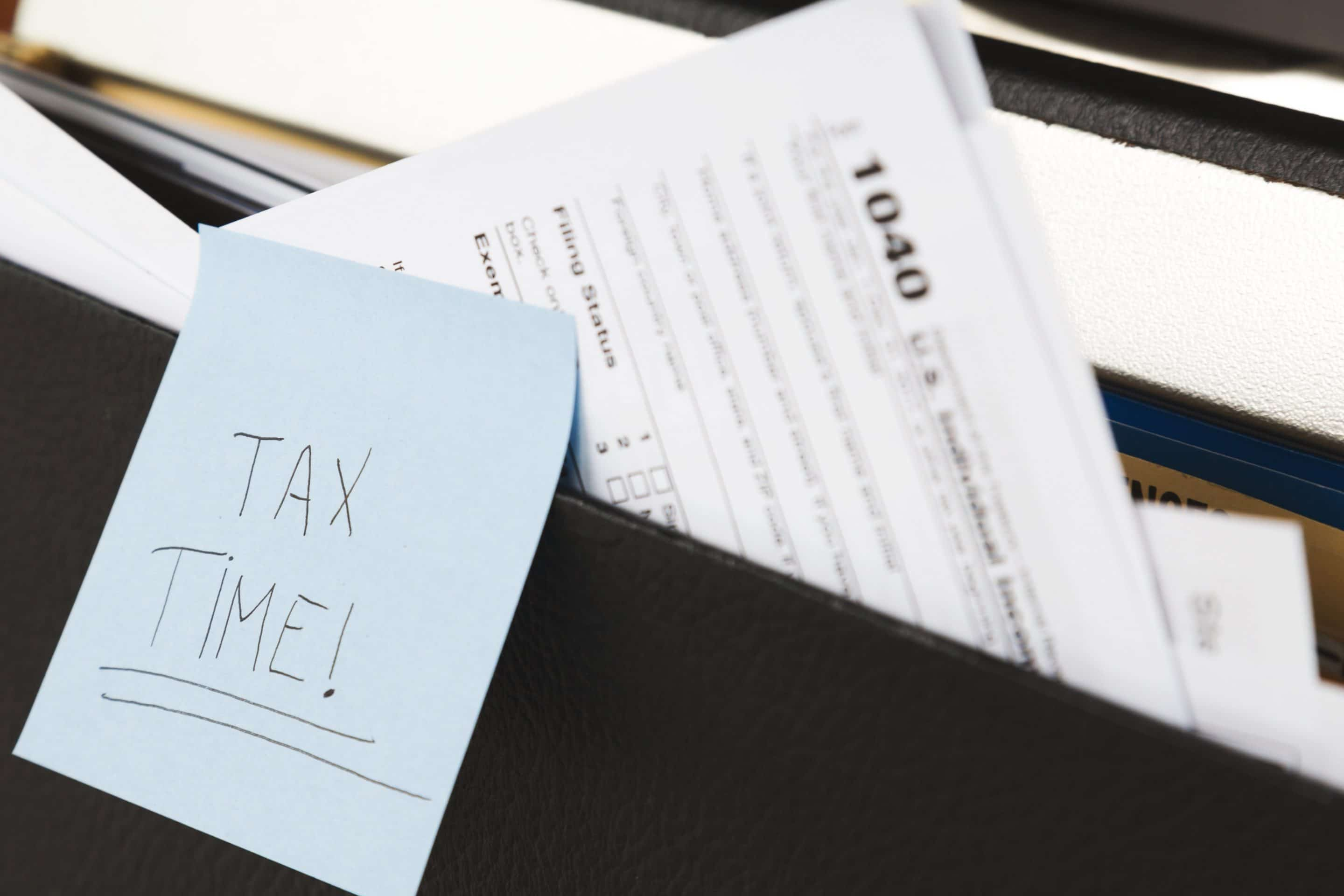 "Post-it with ""Tax Time!"" written on it"